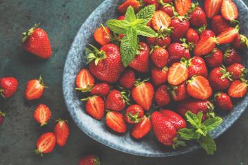top view of fresh ripe strawberries, blueberries and blackberries on dark table with copy space Fototapete
