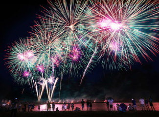 Crowd watching fireworks on the beach..