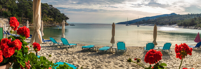 Wall Mural - Landscape with sun umbrella and lounge chair on Aliki beach at Thassos islands, Greece