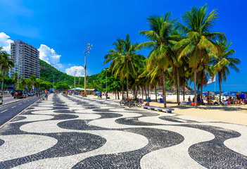 Fototapete - View of Leme beach and Copacabana beach with palms and mosaic of sidewalk in Rio de Janeiro, Brazil