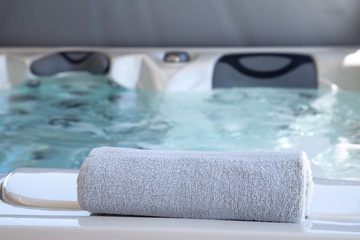 bath towel placed on the edge of a therapeutic spa