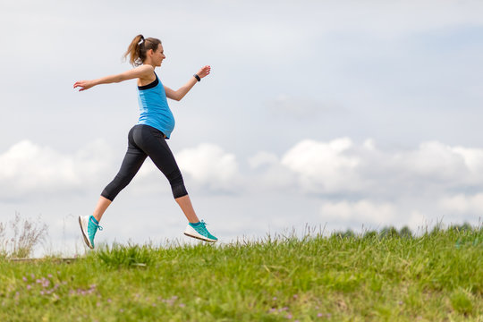 Running during pregnancy, pregnant woman working out outdoor