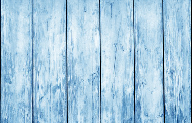 Weathered wooden fence in navy blue color.