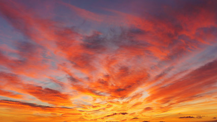 beautiful cloudscape at sunset with red clouds on sky