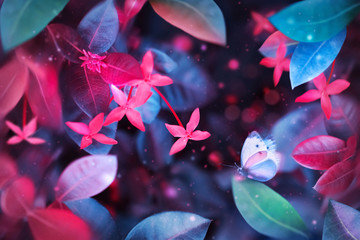 Fantastic summer tropical colorful butterfly, flowers and leaves. Bright natural spring summer ultra image. Ultraviolet, pink, red, blue and aquamarine color.