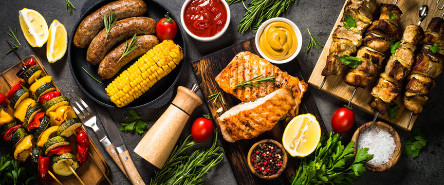 Barbeque dish - Grilled meat, fish, sausages and vegetables.