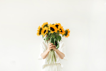 Young girl with sunflowers bouquet in hands on white background. Summer floral composition. Fototapete