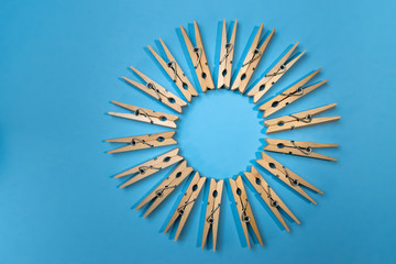 clothespins on vibrant blue in circle pattern
