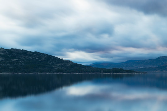Beautiful reflections of clouds and mountains in the water of a lake