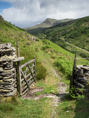 Open gate with path leading to White Pike in the English Lake District