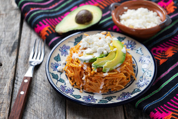 Mexican fideos dry soup with avocado and cheese