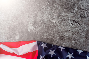 American flag in front of grey background