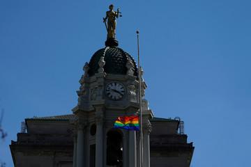 A rainbow flag flies over the Brooklyn Borough Hall in the Brooklyn borough of New York