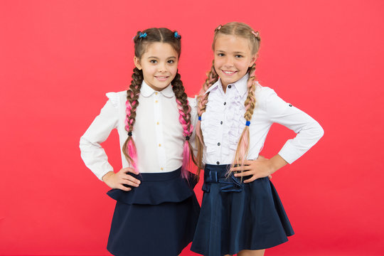 Schoolgirls with cute hairstyle and happy smiles. Best friends excellent pupils. Schoolgirls tidy appearance glad to meet you. Meet new friends in school. School friendship. Should school be more fun