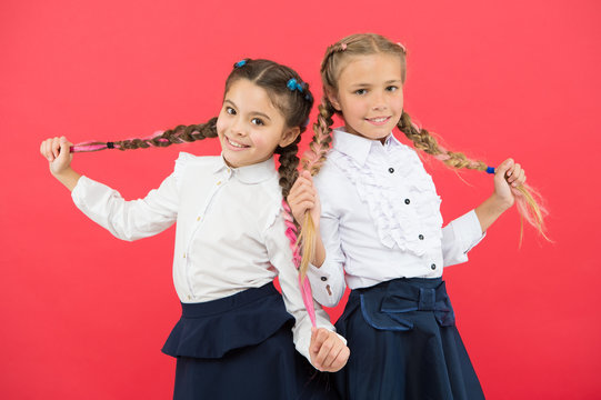 Schoolgirls tidy appearance glad to meet you. Meet new friends in school. School friendship. Should school be more fun. Schoolgirls with cute hairstyle and happy smiles. Best friends excellent pupils