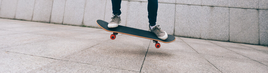 woman skateboarder legs skateboarding at city
