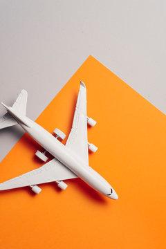 jet airplane travel concept, minimal art, orange background.