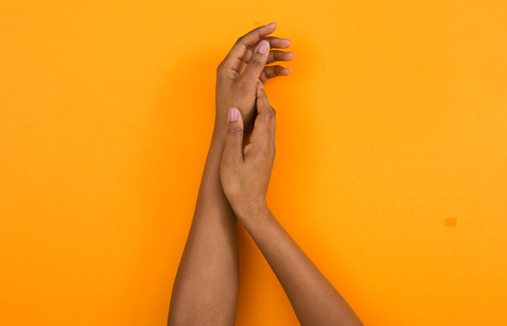 African american woman hands applying moisturizing cream