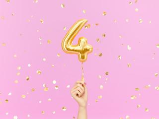 Fototapeta Four year birthday. Female hand holding Number 4 foil balloon. Four-year anniversary background. 3d rendering obraz