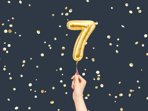 Seven year birthday. Female hand holding Number 7 foil balloon. Seven-year anniversary background. 3d rendering