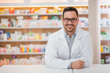 Tuinposter Apotheek Smiling portrait of a handsome pharmacist.