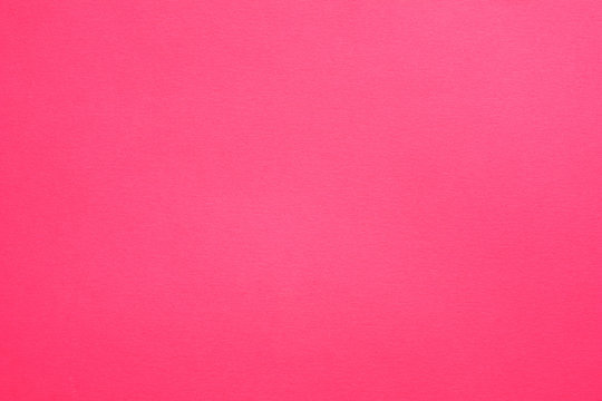 Hot pink felt texture abstract art background. Solid color construction paper surface. Empty space.