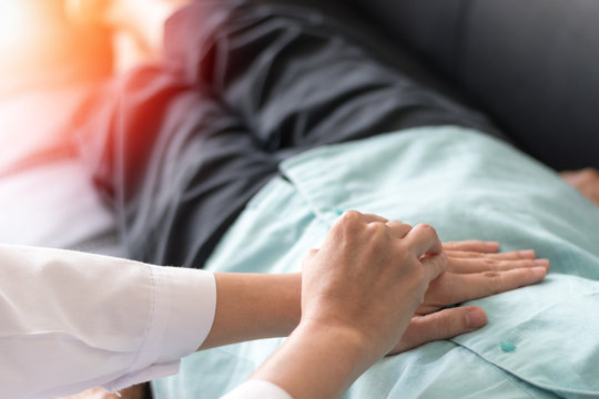 Patient with doctor checking on stomach diseases or gastropathy include gastritis, gastroparesis, diarrhea on senior old female person in hospital.