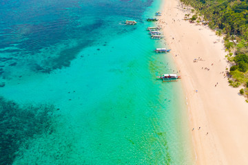 Tuinposter Luchtfoto Puka Shell Beach, Boracay Island, Philippines, aerial view. Tropical white sand beach and beautiful lagoon. Tourist boats and people on the beach. People relax on the beautiful coast.