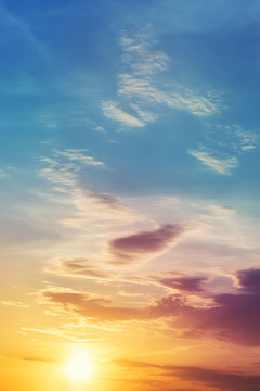Dramatic colorful sunset or sunrise sky landscape. Natural beautiful dawn background wallpaper. Twilight time cloudscape