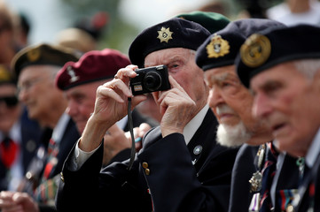 British WWII D-Day veterans attend a ceremony near Pegasus Bridge, as France prepares to commemorate the 75th anniversary of the D-Day, in Ranville