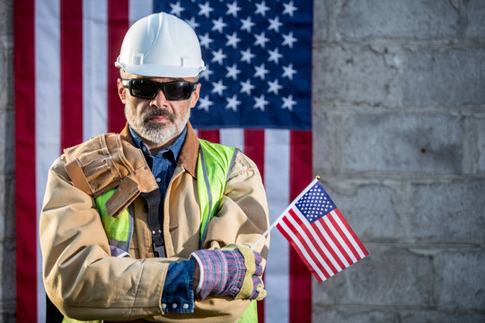 A serious worker man and american flag