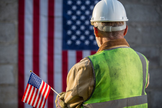 American builder with stars and stripes flag in background