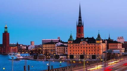 Fototapete - Stockholm, Sweden. Time-lapse of Gamla Stan in Stockholm, Sweden with landmarks like Riddarholm Church during the sunrise. View of old buildings and car traffic at the bridge, panning video