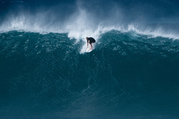 Wall Mural - Surfer rides giant wave at the famous Banzai Pipeline surf spot located on the North Shore of Oahu in Hawaii