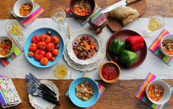 Family dinner variety of meals dishes with glass of wine on wooden table. Dinner table. a variety of snacks, festive