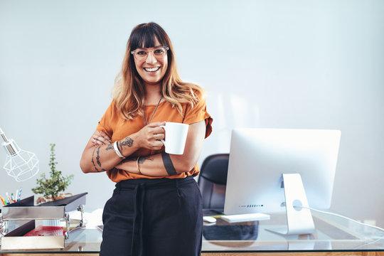 Creative woman entrepreneur standing in office