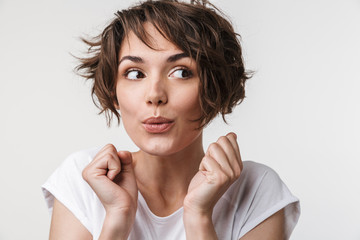 Wall Mural - Young pretty excited shocked woman posing isolated over white wall background.