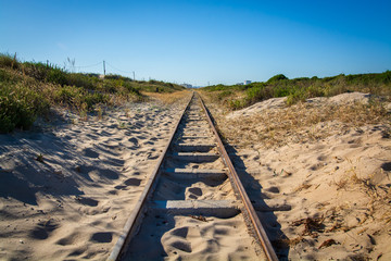train track in sand dunes