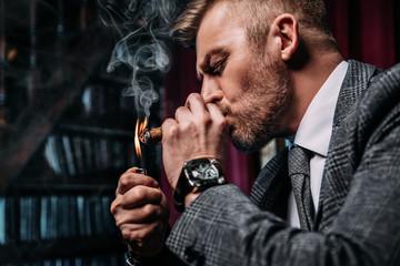 smoking cigar in interior.