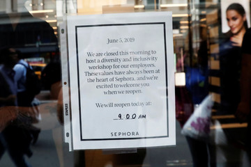 A sign is seen posted on the door of LVMH's Sephora beauty chain which closed in the morning to conduct diversity training for employees in New York City