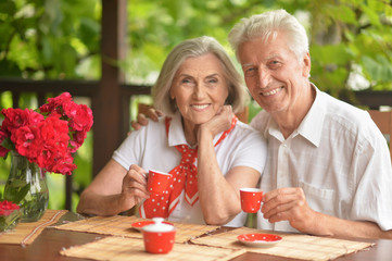 Portrait of happy senior couple drinking coffee