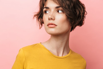 Wall Mural - Young beautiful woman posing isolated over pink wall background.
