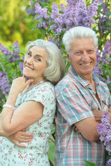 Beautiful senior couple posing in the park