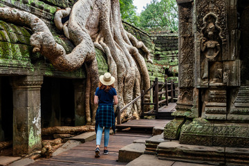 Siem Reap, Cambodia, Traveler Exploring Ta Prohm Temple at Angkor