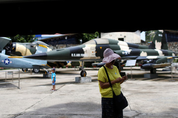 A tourist is seen in front of the F-5A U.S. fighter jet at the War Museum in Ho Chi Minh