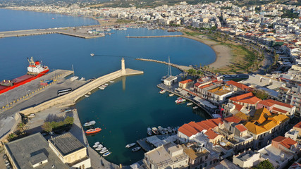 Aerial drone photo of unique old picturesque Venetian port with old lighthouse in the heart of famous city of Rethymno, Crete island, Greece