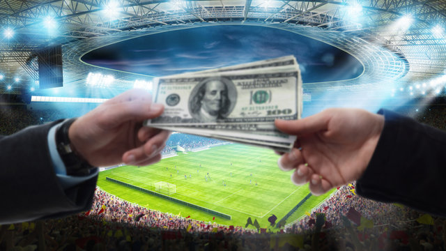 Transfer of money between two hands at the soccer stadium