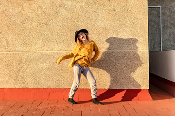 Portrait of girl singing and dancing on roof terrace