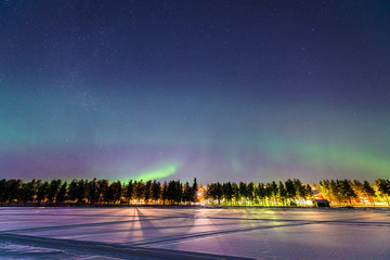 Aurora Borealis over Jokkmokk and the Lake Talvatis, in the heart of Swedish Lapland within the Arctic Circle