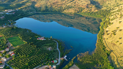 Aerial drone panoramic photo of famous natural lake of Kournas with amazing colours and unique nature surrounded by mountains, Chania prefecture, Crete island, Greece